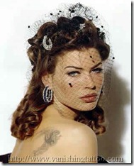 carre-otis-tattoos