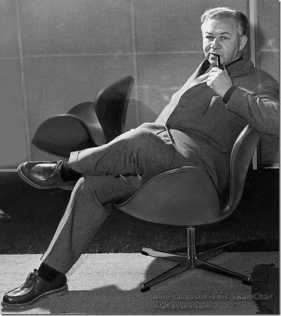 Arne Jacobsen in his Swan Chair